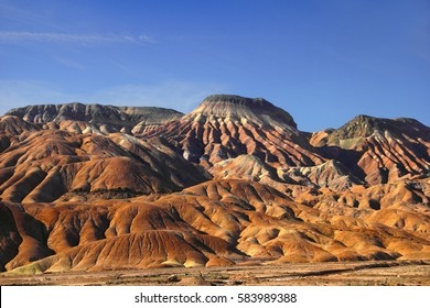 Amazing nature view - fantastic colorful mountain range in evening sun light against the background of bright blue sky in Maranjab desert, Tehran - Isfahan road, Iran, Middle East, Western Asia