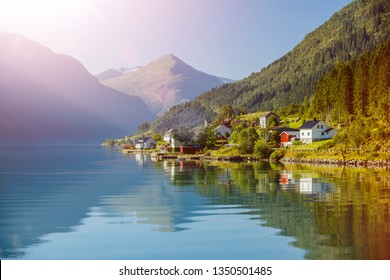 Amazing nature view with fjord and mountain. Beautiful reflection. Location: Scandinavian Mountains, Norway. Artistic picture. Beauty world