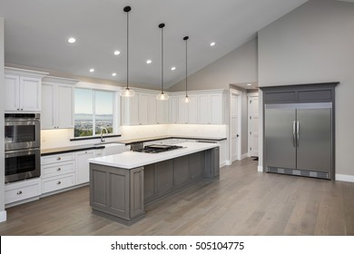 Amazing new contemporary white Kitchen with kitchen Island.