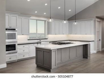 Amazing new contemporary white Kitchen with kitchen Island and view window.