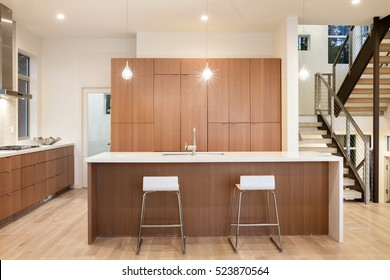 Amazing New Contemporary Wooden Kitchen With Kitchen Island And Bar Chairs.