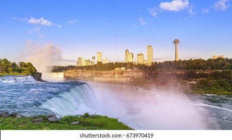 The amazing Niagara Falls as seen from the American side overlooking the Canadian side on a sunny summer morning.