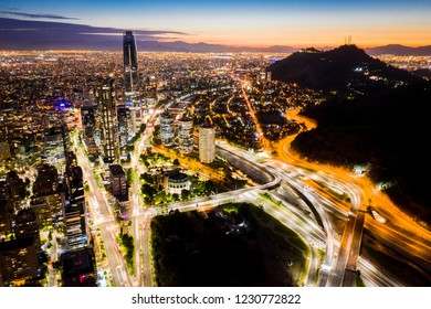 Amazing night cityscape of modern big city with illuminated buildings and urban highways