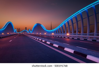 Amazing night dubai VIP bridge with beautiful sunset. Private road to Meydan race course, Dubai, United Arab Emirates