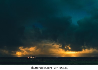 amazing night sky with orange glow and heavy clouds