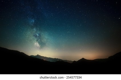amazing night sky stars panorama with milky way on mountain background