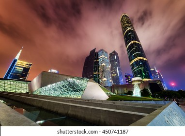 Amazing night view of the Guangzhou Opera House, skyscrapers and other modern buildings at the Zhujiang New Town, China. The Guangzhou International Finance Centre (West Tower) is visible at right.