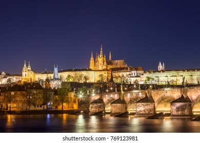 Amazing night view of Hradcany (Prague Castle) with St. Vitus Cathedral and Charles bridge at night, Bohemia landmark. Prague, Czech Republic.