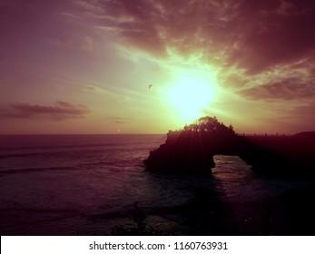 Amazing Ocean Sunset Scenery Of Batu Bolong Temple At Tanah Lot Area, Tabanan, Bali, Indonesia