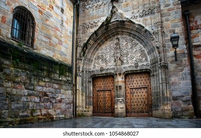 amazing old medieval architecture with wooden door in cathedral of Bilbao. Spain