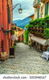 Amazing old narrow street view, famous picturesque cobblestone street with souvenir shops, restaurants and cafes in Bellagio touristic resort, Lake Como, Italy, Europe