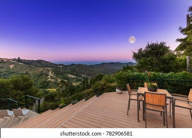 Amazing outdoor patio at night with amazing hillside view and moon.