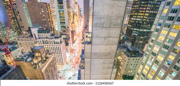 Amazing overhead night view of Manhattan streets and skyscrapers - New York City - USA.