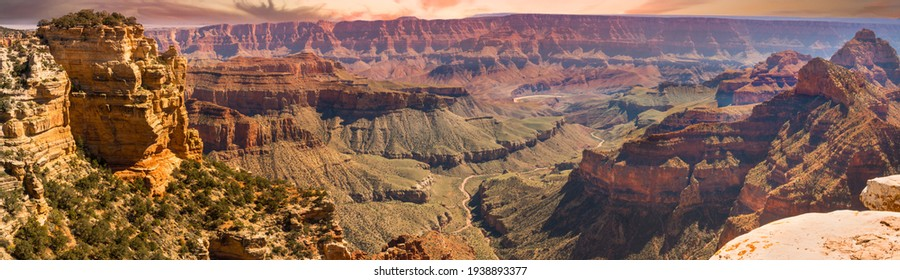 Amazing pano view of the Grand Canyon from the south rim.  The convoluted gorge formed over millions of years by the Colorado River (visiable in this image), erosion, and gravity.  Incredible vista!
