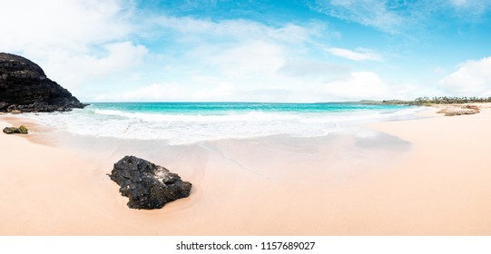 Amazing Panorama Photo of Beautiful Island Paradise of Clear Aqua Blue Ocean Waves Coming on Sandy Seashore and White Sand Beach and Rock Cliffs on Perfect Day in Molokai Hawaii