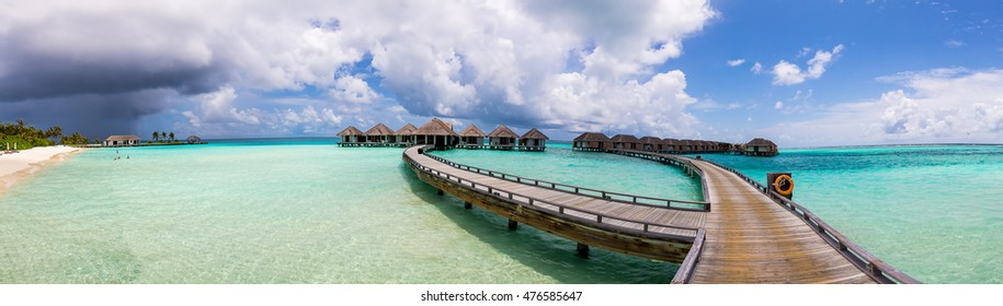 Amazing panorama view from the jetty on Maldives with a storm and rain on the horizon.