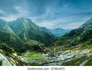 Amazing panorama view of rice terraces fields in Ifugao province mountains under cloudy blue sky. Banaue, Philippines UNESCO heritage