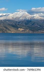 Amazing panoramic Landscape of Lake Pamvotida, Pindus mountain and city of Ioannina, Epirus, Greece