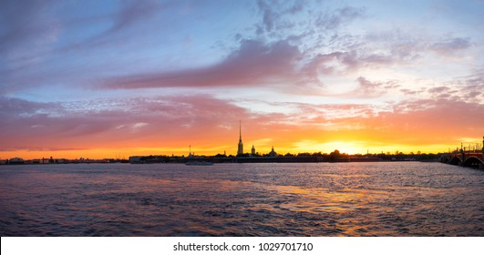Amazing panoramic landscape with Peter and Paul fortress at sunset time, ferry passing along the Neva river, St. Petersburg, Russia