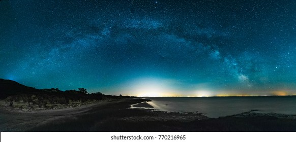 Amazing Panoramic Landscape view of Milky way over Night sky