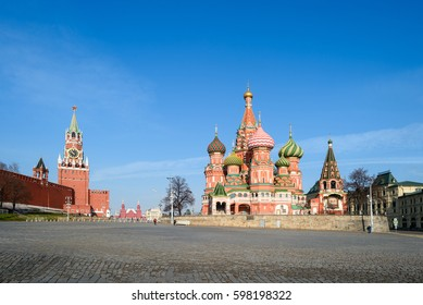 Amazing perspective of St Basil's church and kremlin tower at red square with blue sky at sunny spring day as background. Travel to Moscow downtown landmarks, historical architecture of Russia capital