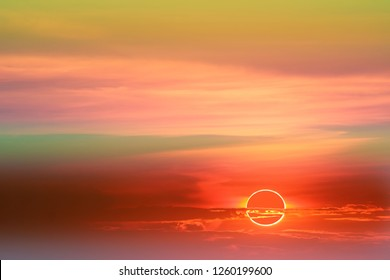 amazing phenomenon of annular eclipse over soft cloud colorful sunset sky