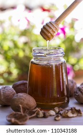 Amazing photo of honey with some walnuts in great background