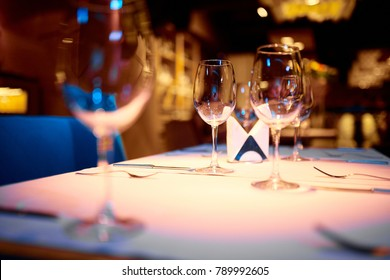 Amazing photo of wine glasses on the table with white tablecloth