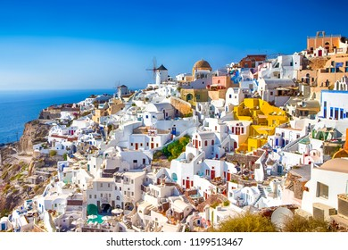 Amazing Picturesque Santorini Island in Greece. Wonderful Daylight Scenery with Traditional Greek White Architecture. Located in Oia Village and Ochre Domed Church.Horizontal Shot