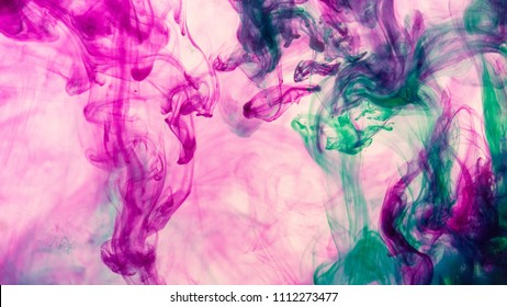 Amazing Pink Purple and Teal ink dropped into water