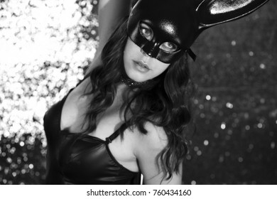 amazing pole dancer posing in a costume with bunny ears