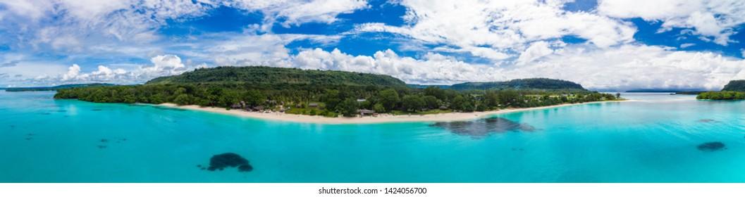 Amazing Port Orly sandy beach with palm trees, Espiritu Santo Island, Vanuatu.