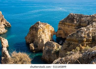 Amazing Portugal nature / Amazing Portugal nature and huge rocks / We can see huge rock holes and Atlantic Ocean at Lagos Portugal.