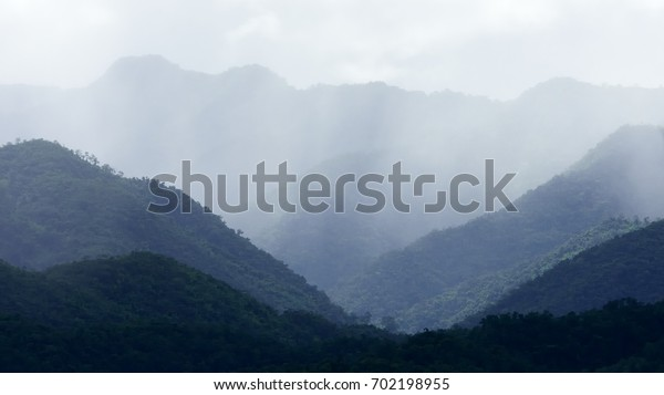 Amazing raining in the tropical mountains landscape when the rainy season in national park of Thailand