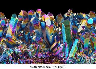 Amazing rare Quartz Rainbow Flame Titanium aura crystal cluster on black background