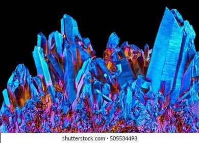 Amazing rare Quartz Rainbow Titanium aura crystal cluster on black background