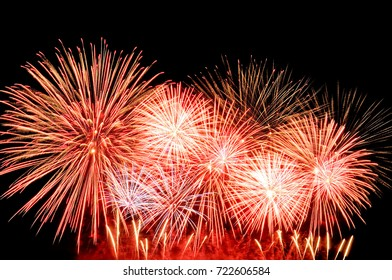 Amazing red fireworks on dark background.