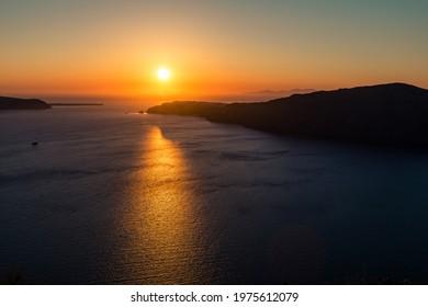Amazing red sunset over Oia and caldera of the Santorini island, Greece - Shutterstock ID 1975612079