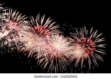 Amazing red and white fireworks on dark background.