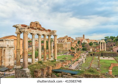 Amazing Roman Forum and Great Colosseum (Coliseum, Colosseo) in the evening,at sunset time.Beautiful architectural and natural landscape.Panoramic view on famous touristic landmark. Rome.Italy.Europe.