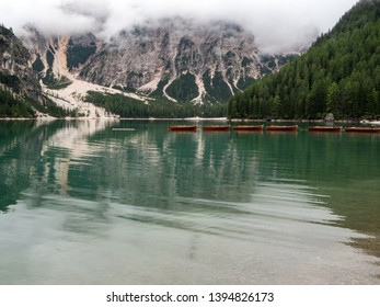 Amazing romantic place with typical wooden boats on the alpine lake,(Lago di Braies) Braies lake,Dolomites,South Tyrol,Italy,Europe