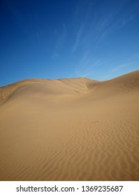 Amazing Sand Dunes in the Desert and a blue sky.