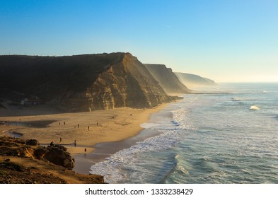 Amazing sandy beach at the sunset. Portugal