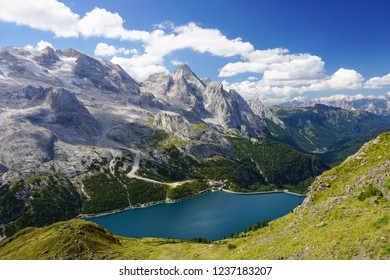 Amazing scene with Marmolada mountain and Lake Fedaia (Lagi di Fedaia) in  Dolomiti / Dolomites Alps in South Tyrol, Italy, on a sunny day of summer
