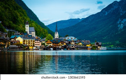 Amazing scenery of austrian town Hallstatt at the lake and high mountains