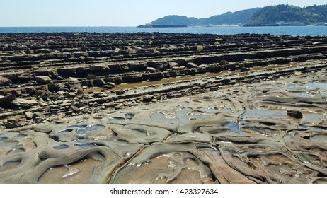 "Amazing scenery of the natural phenomenon of stone beach coastline that looks like the natural stairs, named ""Giant's washing plate"" in Aoshima Island, Miyazaki Province, Kyushu, Japan."