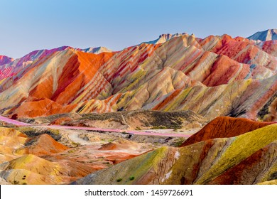 Amazing scenery of Rainbow mountain and blue sky background in sunset. Zhangye Danxia National Geopark, Gansu, China. Colorful landscape, rainbow hills, unusual colored rocks, sandstone erosion