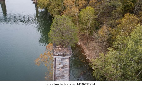 Amazing Scenic Aerial Drone Photographic View Looking Down at Unusual Green Tree Growing on Abandoned Historical Brick Stone Pillar Pedestal Remains of Aged Destroyed Bridge on the Potomac River.
