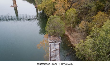 Amazing Scenic Aerial View of Green Tree Growing on Abandoned Dilapidated Brick Stone Pillar Pedestal Remains of Old Destroyed Structure on Potomac River.