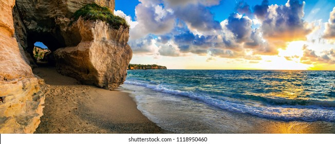 amazing sea sunset in small hidden beach in Tropea, Calabria, Italy
